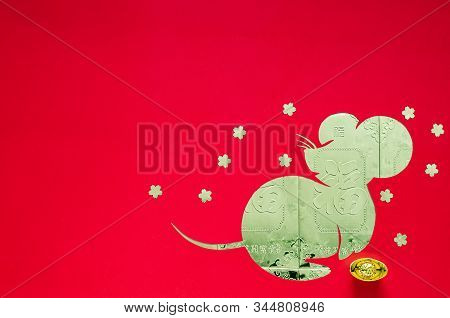 Chinese New Year Festival Decoration On Red Background That Cut In Rat Shape Put On Money Gold Packe