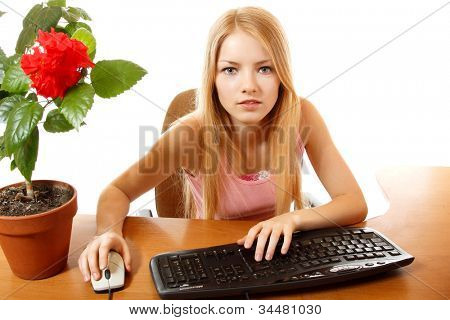 teen girl with internet dependence looking in monitor, isolated on white