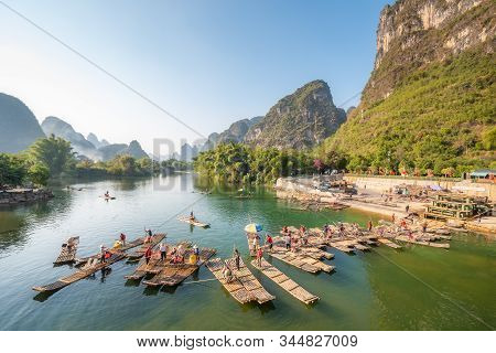 Yangshuo, Guilin, Guangxi Province, China - Nov 9, 2019 : Tourist Bamboo Rafts Arriving At The End O
