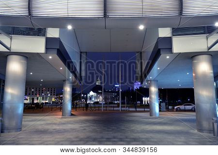 Night Architecture - Building With Glass Facade. Modern Building In  Business District. Concept Of E