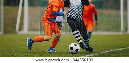 Junior Soccer Match Duel. Football Game For Youth Players. Boys Playing Soccer Match On Football Pit
