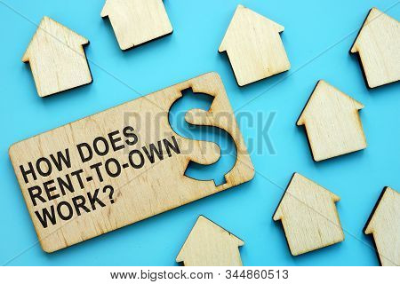 How Does Rent-to-own Work Sign On The Wooden Plate.