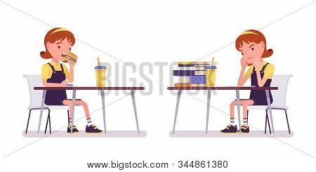 School Girl Studying And Eating At The Desk. Cute Small Lady In A Pretty Pinafore Dress, Active Youn