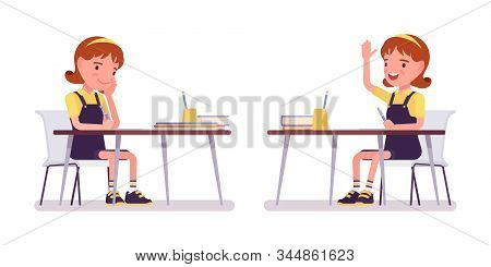 School Girl Studying At The Desk, Raise Hand To Speak. Cute Small Lady In A Pinafore Dress, Active Y