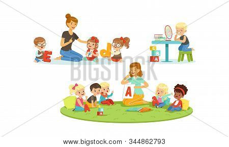 Speech Therapist Working With Children, Teacher Explaining Alphabet To Kids, Boys And Girls Playing