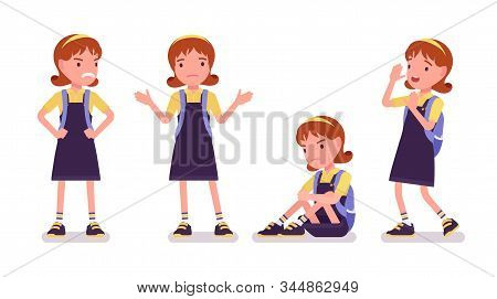 School Girl Negative Emotions. Unhappy Small Lady In A Pretty Pinafore Dress With Rucksack, Active Y