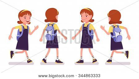 School Girl Running. Cute Small Lady In Pretty Pinafore Dress With Rucksack, Active Young Kid, Smart