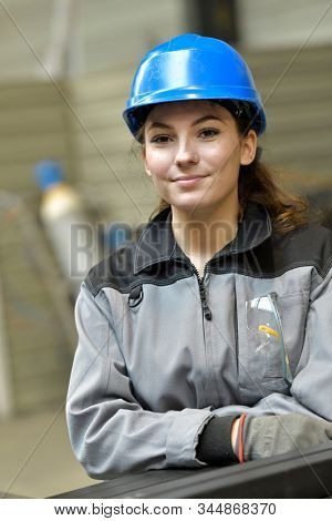 Portrait of steelworks apprentice with security helmet