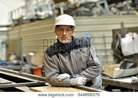 Portrait of steelworker working in plant