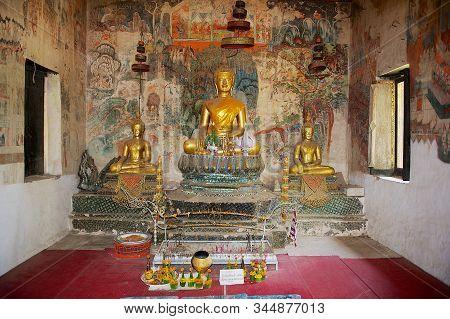 Luang Prabang, Laos - April 14, 2012: Buddha Statues And Interior Of The Wat Pa Huak Temple In Luang