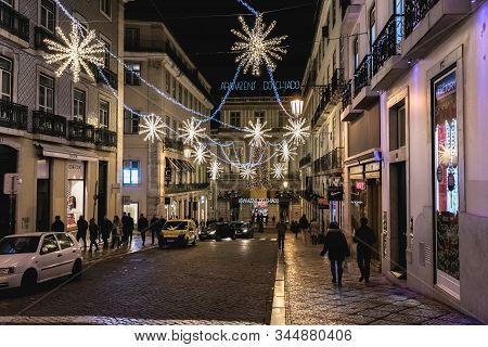 Street Atmosphere In Lisbon At Night Decorated For Christmas