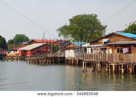 Plank Houses Built On Stilts At The Clan Jetties, A Unesco World Heritage Site,  In The Morning,  Ge