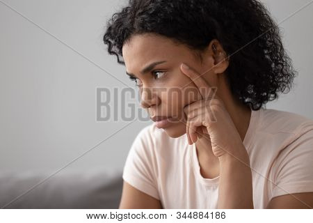 Closeup African Pensive Woman Sit Indoors Feels Discontented Having Problems