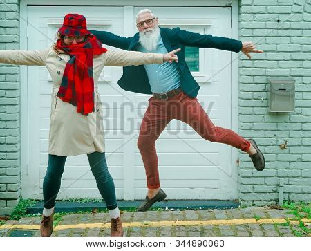 Man And Woman Jumping Near To The Garage, Blond Wife Joking Enjoy Funny Time Together,  Happy Long L
