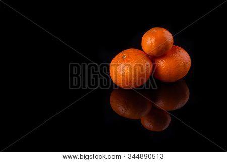 Orange Hill Isolated. Citrus Trio In Dark Space.