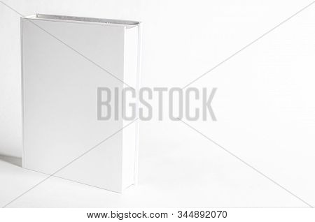 Mockup Of Closed Blank Square Book At White Textured Paper Background