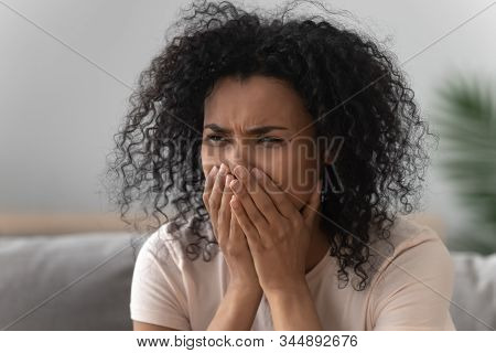 Grieving African Woman Crying Sitting On Couch