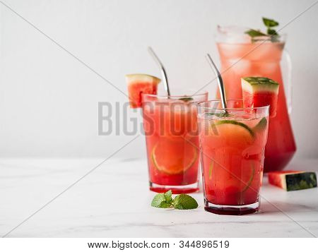 Watermelon Cooler With Lime, Mint And Ice. Perfect Homemade Watermelon Drink In Glasses With Metal S