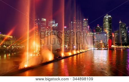 Singapore-november 29, 2019: Night Show Of Fountains In Singapore Near The Marina Bay Sands Hotel Ag