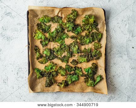 Green Kale Chips With Salt On Oven-tray. Homemade Healthy Snack For Low Carb, Keto, Low Calorie Diet