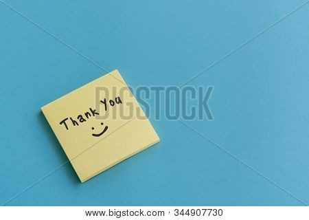 Thank You Note On Stocky Note On Blue Background