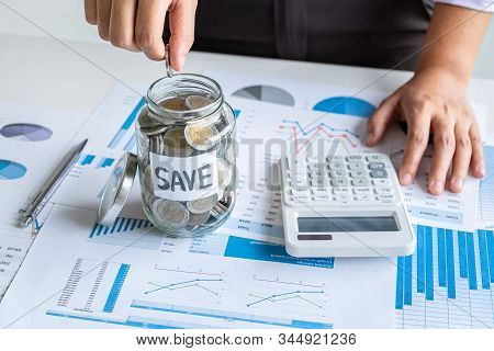 Woman Putting Coin In Bottle For Step Up Growing Business To Profit And Saving With Money Box, Savin