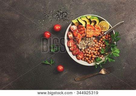 A Bowl Of Healthy Vegan And Vegetarian Lunch Or Dinner. Salad Of Fried Chickpeas, Quinoa, Avocado, F