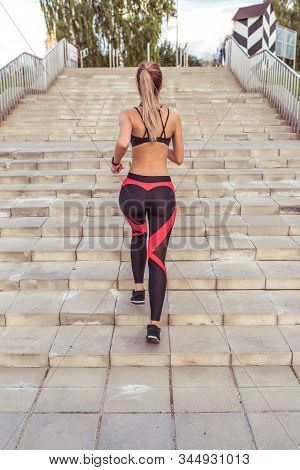 Beautiful Girl Morning Training Run On Stairs, City In Summer, View From Back. Fitness Training Acti