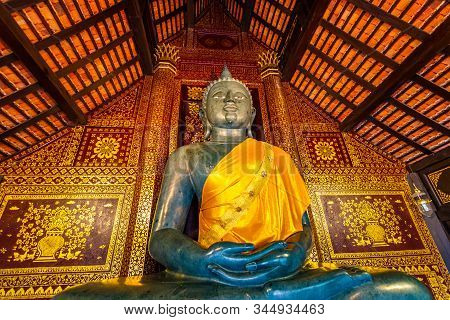 Statue Of Buddha In Small Temple Near Wat Chedi Luang Temple, Thailand. Spiritual Place With Beautif