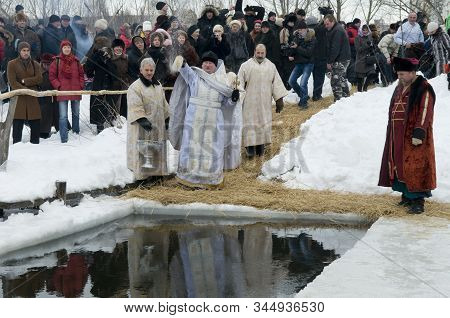 People Look At Baptismal Rite