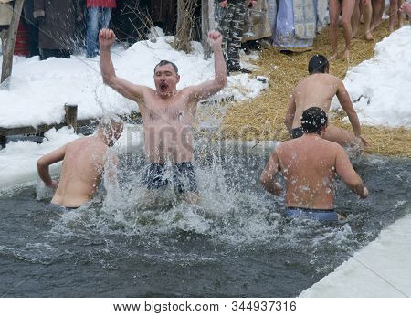 Men In Ice Hole _ Baptism Of Jesus Holiday