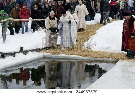 People Look At The Baptismal Rite