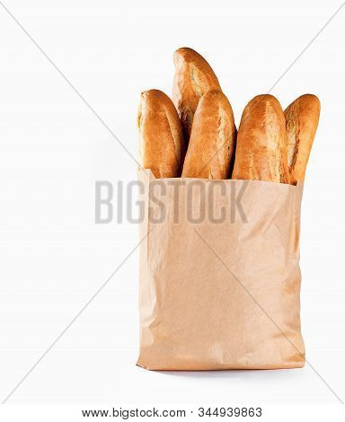 Baguette Bread In Paper Bag On White Background