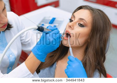 Cleaning And Polishing Tooth Enamel In The Dental Office.