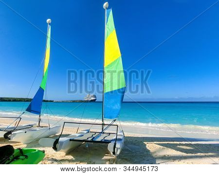 Colorful Sailboats And Motorboat, On A Tropical Beach At Half Moon Cay In The Bahamas On A Tropical