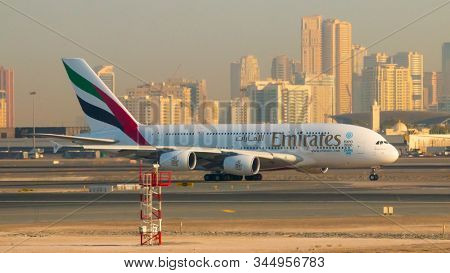 DUBAI, UAE - NOVEMBER 20, 2019: The Airbus A380 Emirates take off on Dubai International Airport. Plane for 615 passengers is biggest airliner on the world.