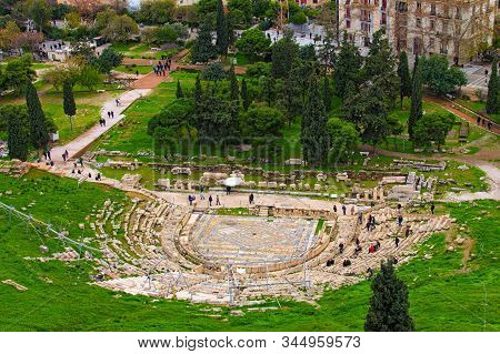 Ancient Theater Of Dionysus Seen From The Hill Of Athens Acropolis. Ancient Ruins. The Theatre Of Di