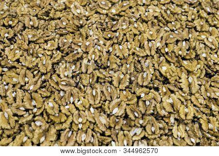 Walnuts. Peeled Walnuts Background Texture. Organic Nuts Pattern. Design Pattern Of Nut. Walnuts Sto