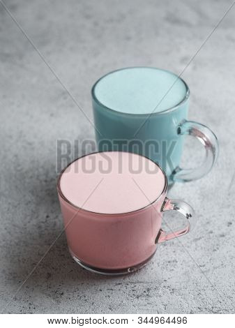 Trendy Drink: Blue And Pink Latte. Top View Of Hot Butterfly Pea Latte Or Blue Spirulina Latte And P