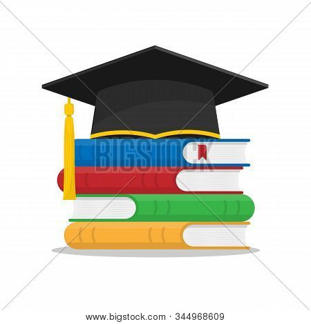 A Stack Of Book And A Cap Or Hat Of A Graduate. Obtaining Knowledge And Education. Studying At Unive