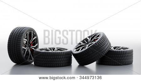 Set of wheels with modern alu rims on white background - banner composition. 3D illustration