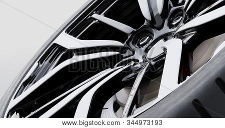 Wheel with modern alu rim on white background - banner composition. 3D illustration