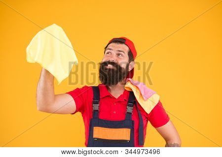 bearded man hold duster microfiber for cleaning. man clean house. housekeeping business. call for cleaning service. male maid household. happy hipster cleaning material in hand. laundering worker. poster