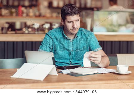Entrepreneur Managing His Small Business - Businessman Looking Overwhelmed - Young Coffee Shop Owner