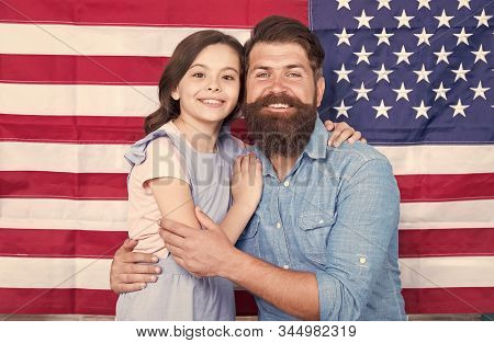 National Glory. Bearded Man And Little Child On National Flag Of The Usa. American Family Celebratin