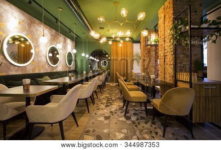 Restaurant In Modern Style, Light Colors Interior With Green Walls And Creative Mirrors, Copy Space