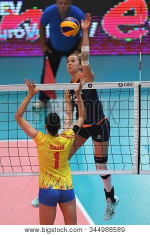 BUDAPEST, HUNGARY – August 23, 2019: Myrthe Schoot (blue) hits the ball, at the Netherlads (blue) – Romania (yellow) 2019 CEV Volleyball European Championship's women volleyball game.
