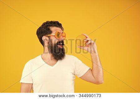 Best Orange Snack. Happy Guy Taking Snack Break On Yellow Background. Hipster Looking At Healthy Org