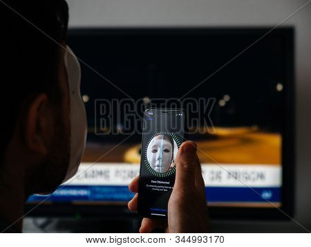 Paris, France - Nov 11, 2017: Rear View Of Face Obstructed Message On Display Of New Apple Iphone Xs