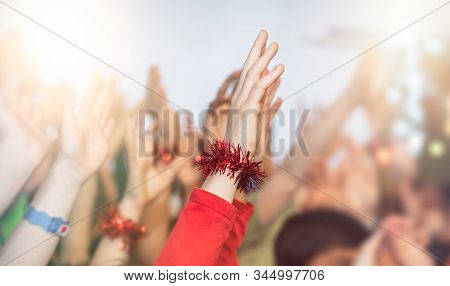 Cheering Crowd Of Happy Children With Hands In The Air At The School Disco Party At Christmas Time